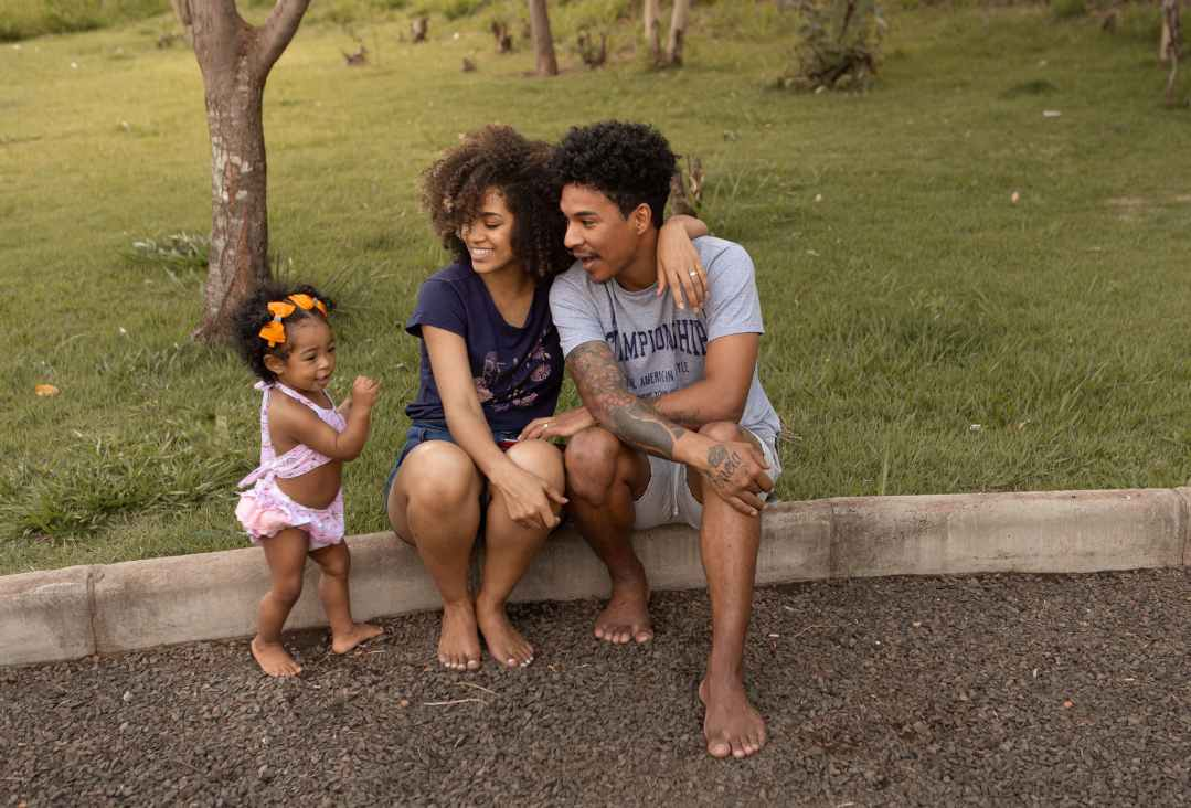 happy black family near lawn with green grass