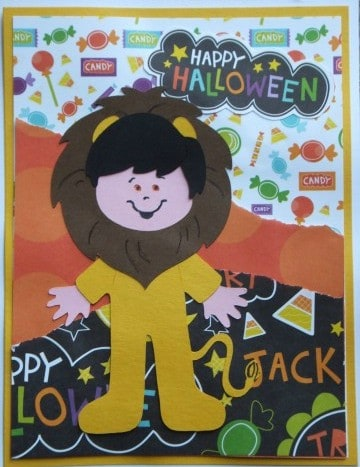 This cute lion is on the Paper Doll Dress Up Cricut Cartridge. He's perfect for a Halloween Cricut Card.