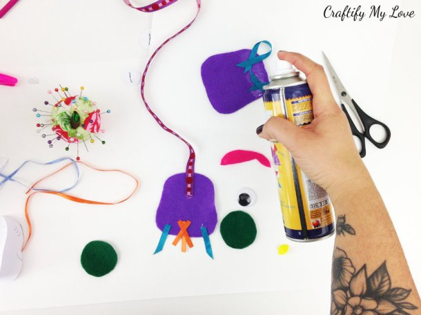 using spray adhesive or glue to create fun layer animal bookmark