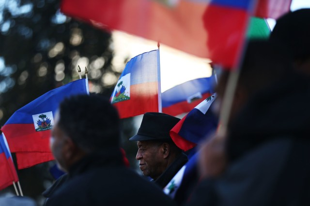 Waving the national flag of Haiti, activists attend a rally in support of immigrants on January 18th, 2018, in Newark, New Jersey.