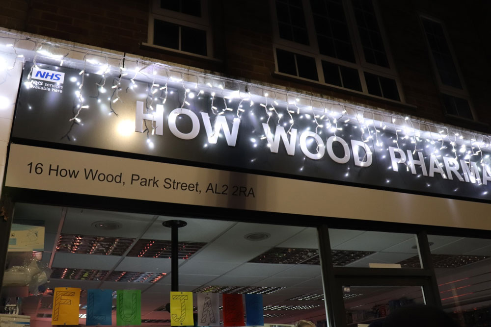 How Wood Pharmacy lit up in lights