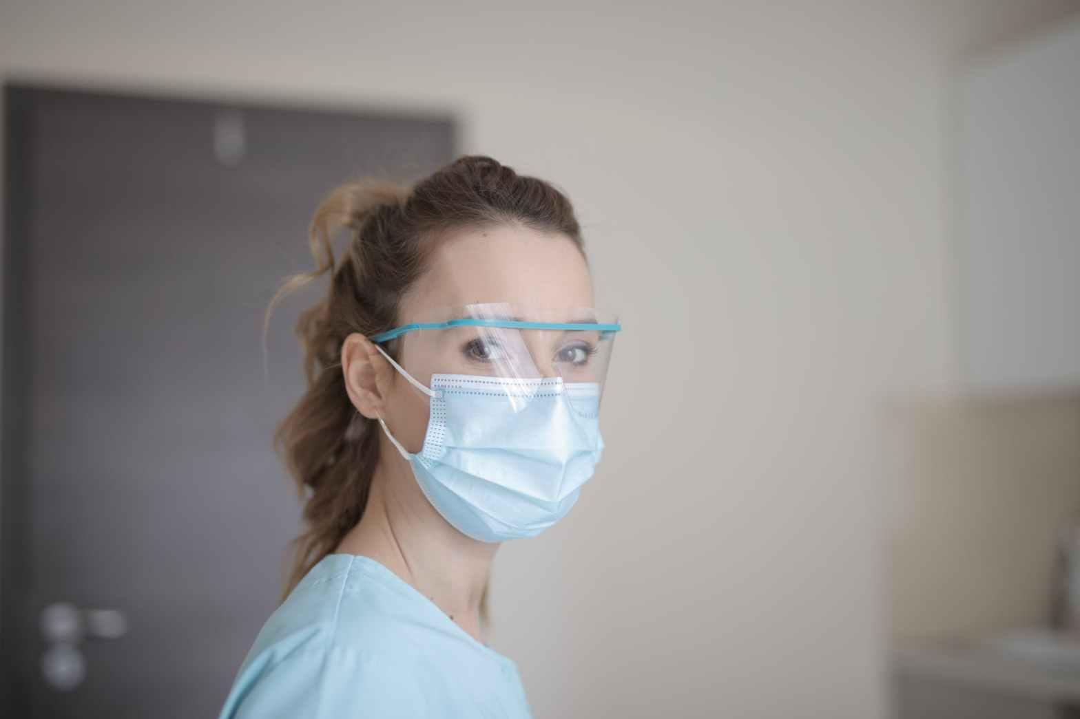 woman in blue shirt wearing face mask