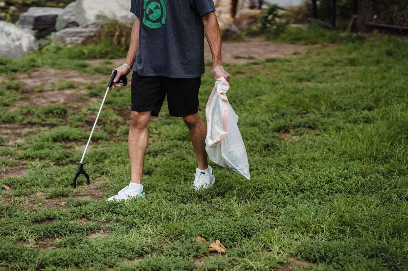 man shorts grass outdoors