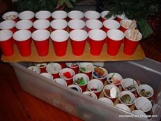 Genius! Hot glue cups to cardboard and store Christmas ornaments in them in tubs.