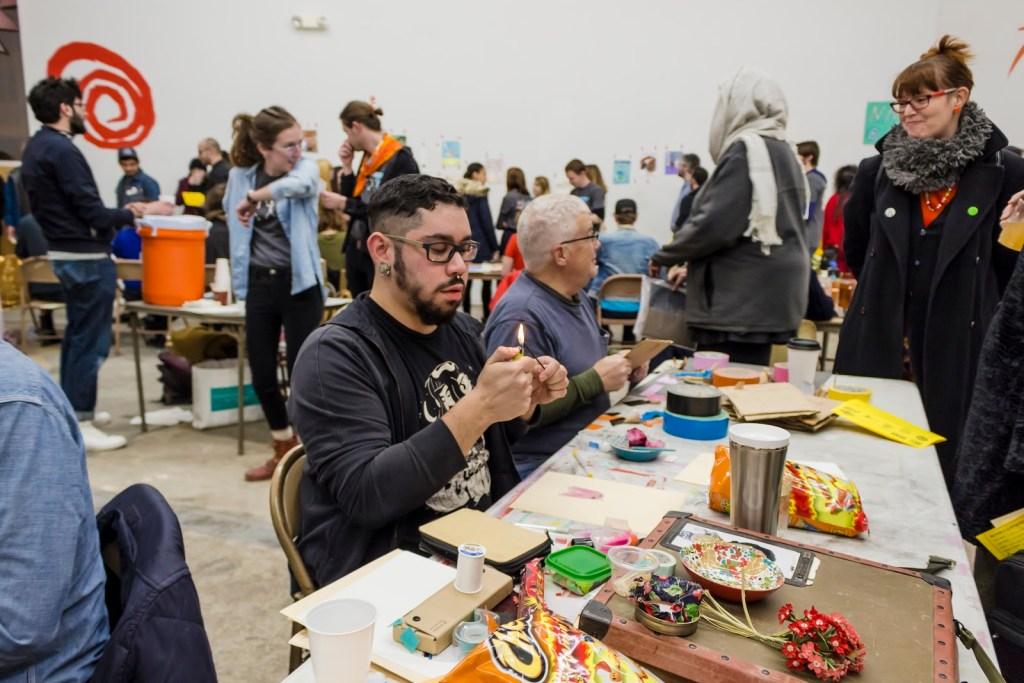 Artists Rodolfo Marron III and Garry Noland making their work during Hot Hands 2017.