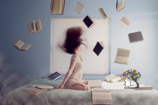 reading a page without knowing woman with books flying around light blue background
