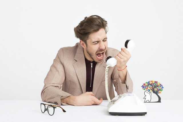 Man Yelling into the Phone