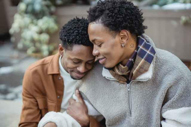 loving black homosexual couple hugging on street