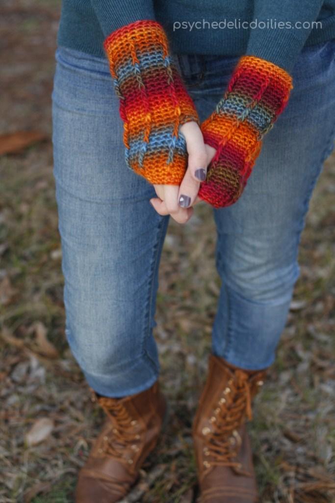 Perpetual Posts Fingerless Gloves. A free wrist warmer crochet pattern using Red Heart Unforgettable yarn.