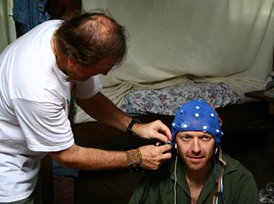 Dr. Juan affixes the EEG skullcap to Rak Razam.