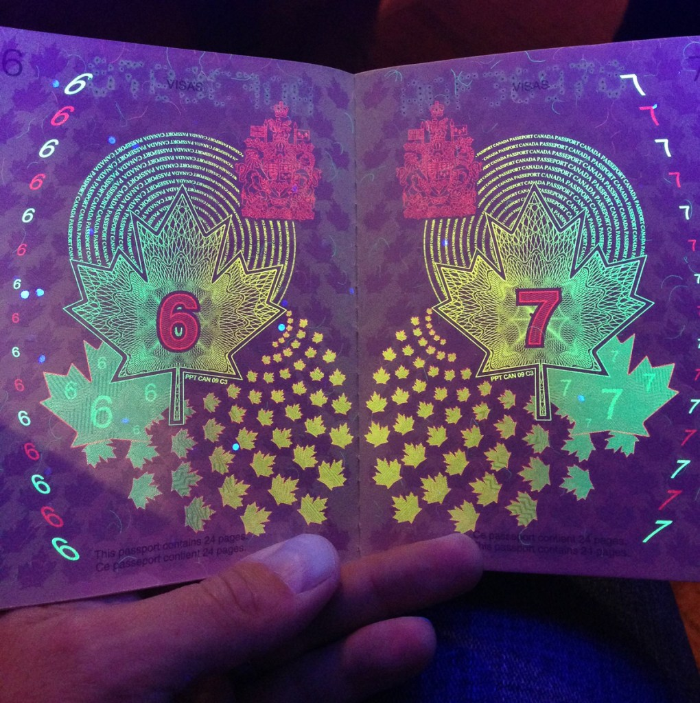 old Canadian passport under a blacklight