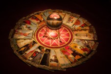 Tarot cards and crystal ball.
