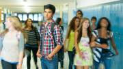A highschool student standing in the hall. Long exposure with motion blur.