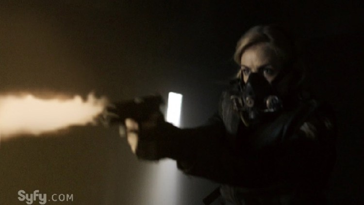Cassie Firing a Pistol that Looks Like a Flame-Thrower