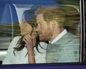 Meghan and harry in car