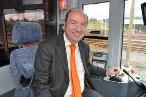 Norman Baker driving a tram