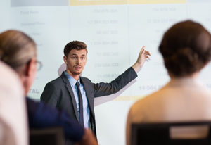 man teaching customers about evaluation with passion
