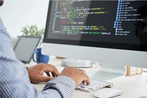 man working on development code