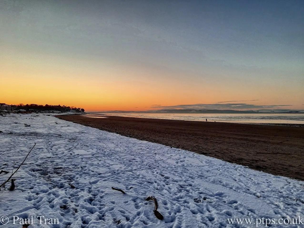 sunset from a snowy beach