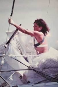 Linda changing head sails on a solo sailing adventure