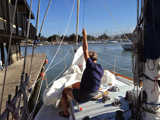 Corine has been working hard to fix some damaged sail hanks on the staysail.