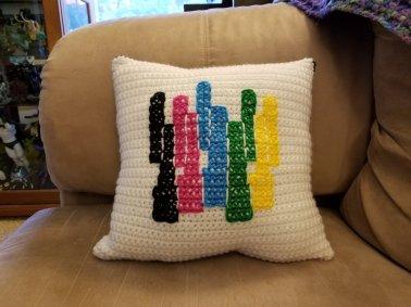 PTX logo pillow by Jonna Peterson. Front.