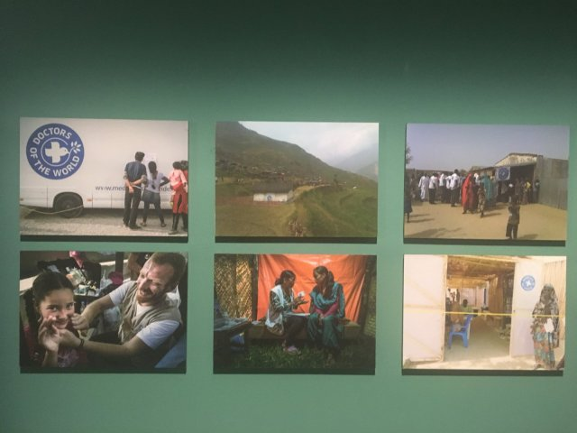 Pictures on view depicting the current state in Haiti, Nigeria, Nepal, and Greece.
