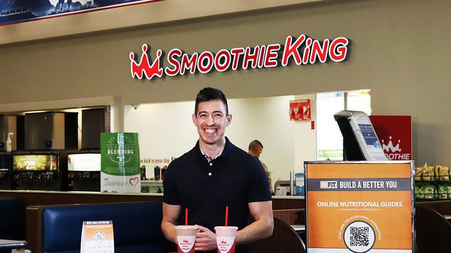Exchange BE FIT Ambassador Roy Montez stands in front of Smoothie King
