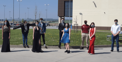 Spangdahlem High School students pose in their formal wear before their shift at the Spangdahlem Exchange on April 25, the day of the high school's cancelled prom.
