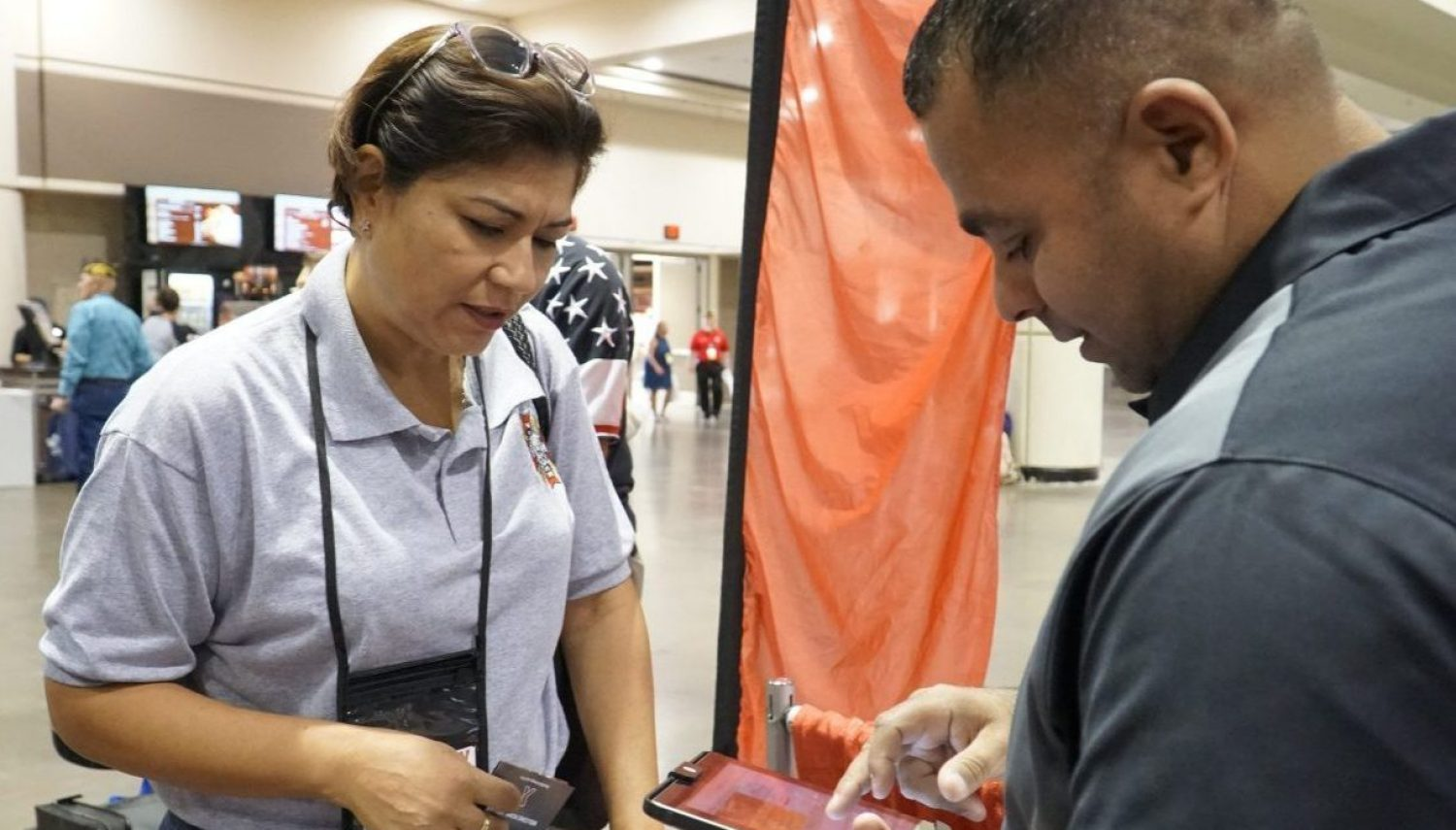 Army Veteran Francis Cordero Medina learns how to sign up for tax-free shopping at ShopMyExchange.com with help from Exchange Veteran Service