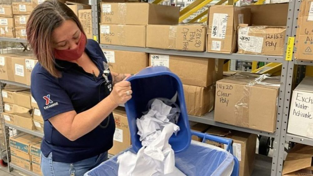 Earth Day - Associate recycling paper at Fort Hood