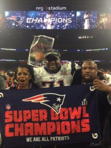 Col. Fleming, left, celebrates the Patriots win with her son at Super Bowl LI.