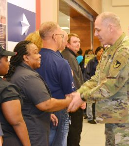GEN Perna shook the hand of each associate recognized, including Rita King.