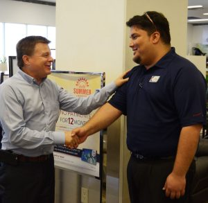 Associate Nicholas Goya from Okinawa welcomes COO Dave Nelson to his facility.