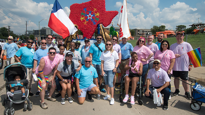 HQ associates and their allies pose for a picture at the Dallas PRIDE parade Sept. 16.