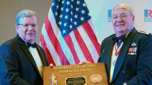Exchange Director/CEO Tom Shull, left, became the 98th member inducted into the Reserve Officers Association Minuteman Hall of Fame on Sept. 29 at ROA's national convention in Omaha. Mr. Shull accepted the award from ROA President Donald Stockton, a retired Air Force Reserve lieutenant colonel, on behalf of the worldwide Exchange team's collective efforts to care for America's citizen-warriors, their families, retirees and Veterans.