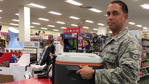 An Airman at Hurlburt Field, Fla., buys a cooler to prepare for Hurricane Michael.