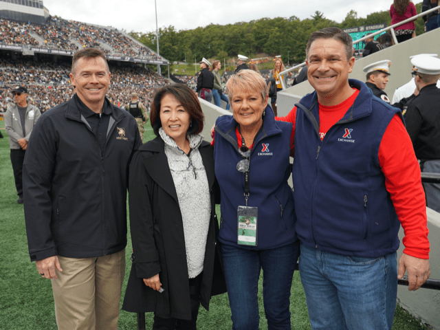 Exchange senior managers at football game.