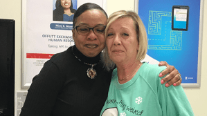Central Region Senior Vice President Marla Smith, left, hugs Offutt AFB Manager Patti Griffin after recognizing Griffin for the kindhearted efforts with a valued customer.