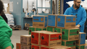Associates with girl Scout cookies in Exchange warehouse