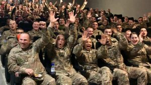 Soldiers at Camp REDLEG in the United Arab Emirates react with joy upon the premier in early March of the newest Captain Marval movie. The Exchange and Disney teamed to show the movie to troops throughout Southwest Asia.