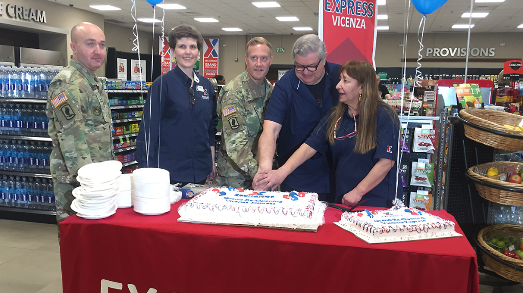 Command Sergeant Major Mason Bryant, General Manager Cindy Brown, Col. Eric Berdy, retired Express  associate Tony Tognoni, and Store Manager Sema Trost open the new Express at the Army garrison in Italy.