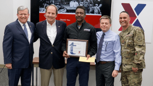 Willie Eagle, center, was honored by Director/CEO Tom Shull, Senior Vice President of Supply Chain Transportation Tom Lozier, Chief Operating Officer Dave Nelson and Chief Master Sgt. Luis Reyes, Exchange senior enlisted advisor, for working at the Exchange for 50 years.