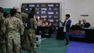Soldiers stand in line to register for the Road to Twitchcon event at Camp Mabry