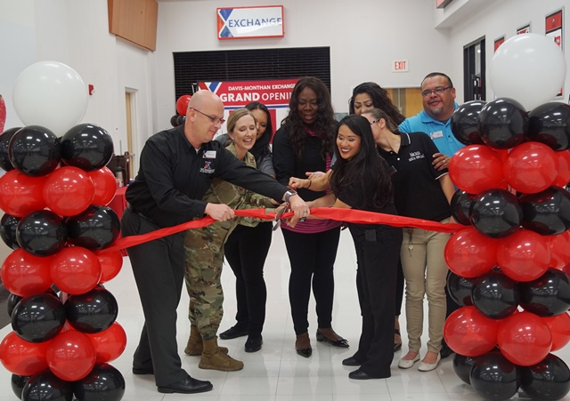 Exchange GM Mikel Hunter, left and 355th Mission Support Group Commander Col. Julie Newlin join associates and concessionaires to open a new durable medical equipment store.