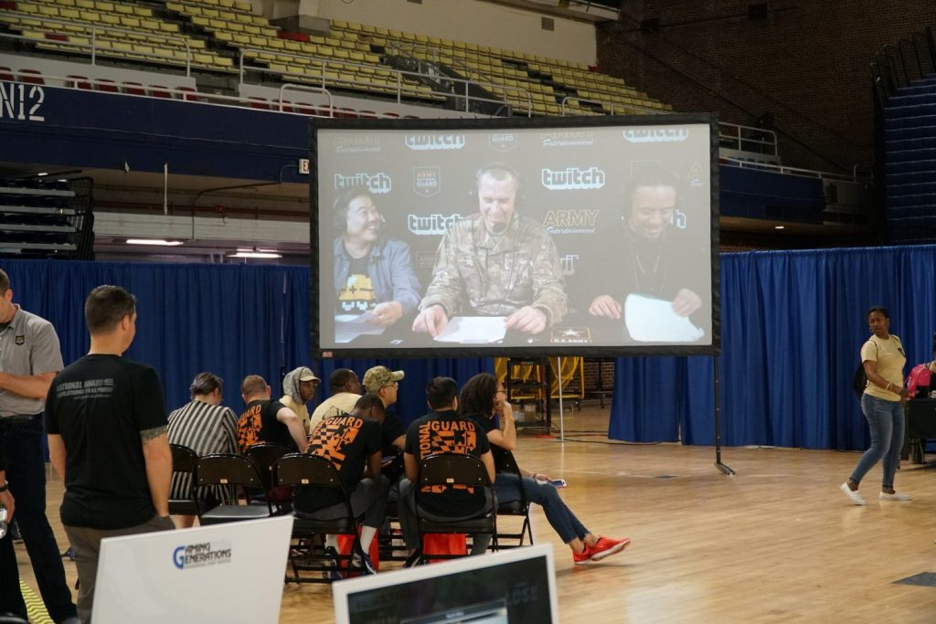 Spectators watch the Twitch commentary team on a big screen