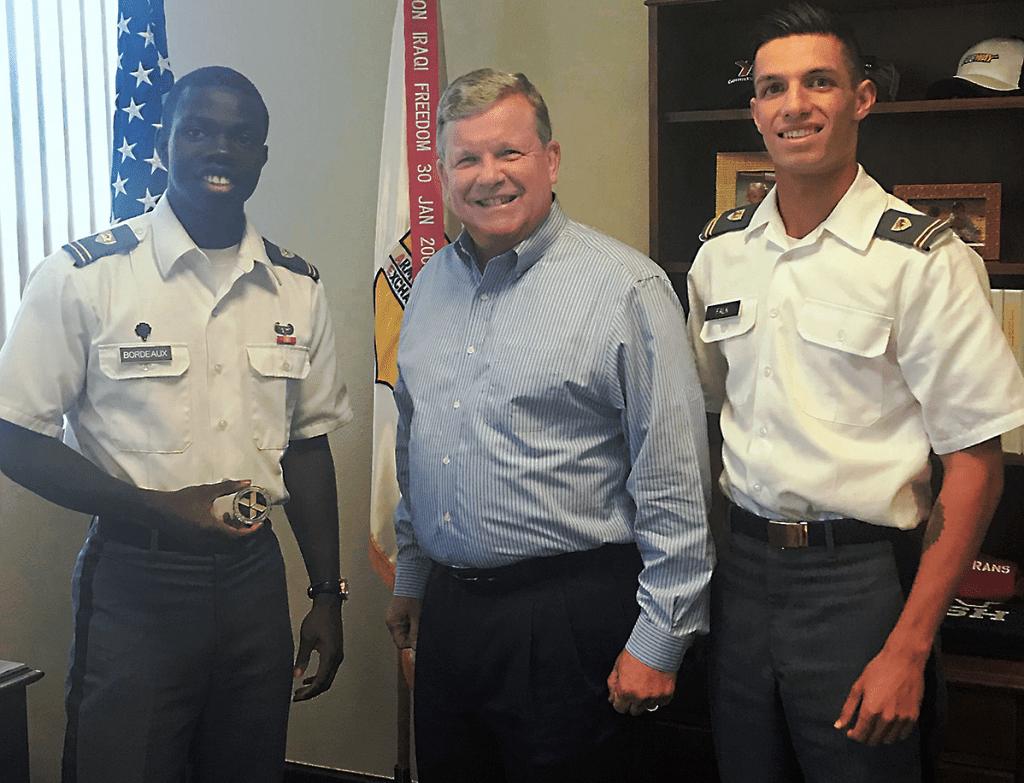 "Director/CEO Tom Shull with USMA Cadets Thomas ""TJ"" Bordeaux, left, and Christian ""CJ"" Falk."