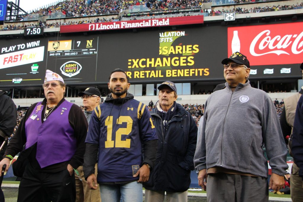 Five Purple Heart recipients recognized during the Army-Navy game received a rousing standing ovation from some 70,000 fans in attendance.