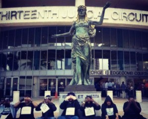 Image embedded in post titled 'amendment 4 undermines felons' voting rights in florida: Did you read probation statutes.' Image by Olivia P walker is of lady justice outside the courthouse in tampa florida