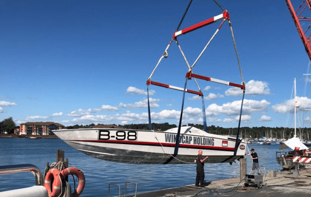 Wild Eleven is lifted into the water at Poole Marina